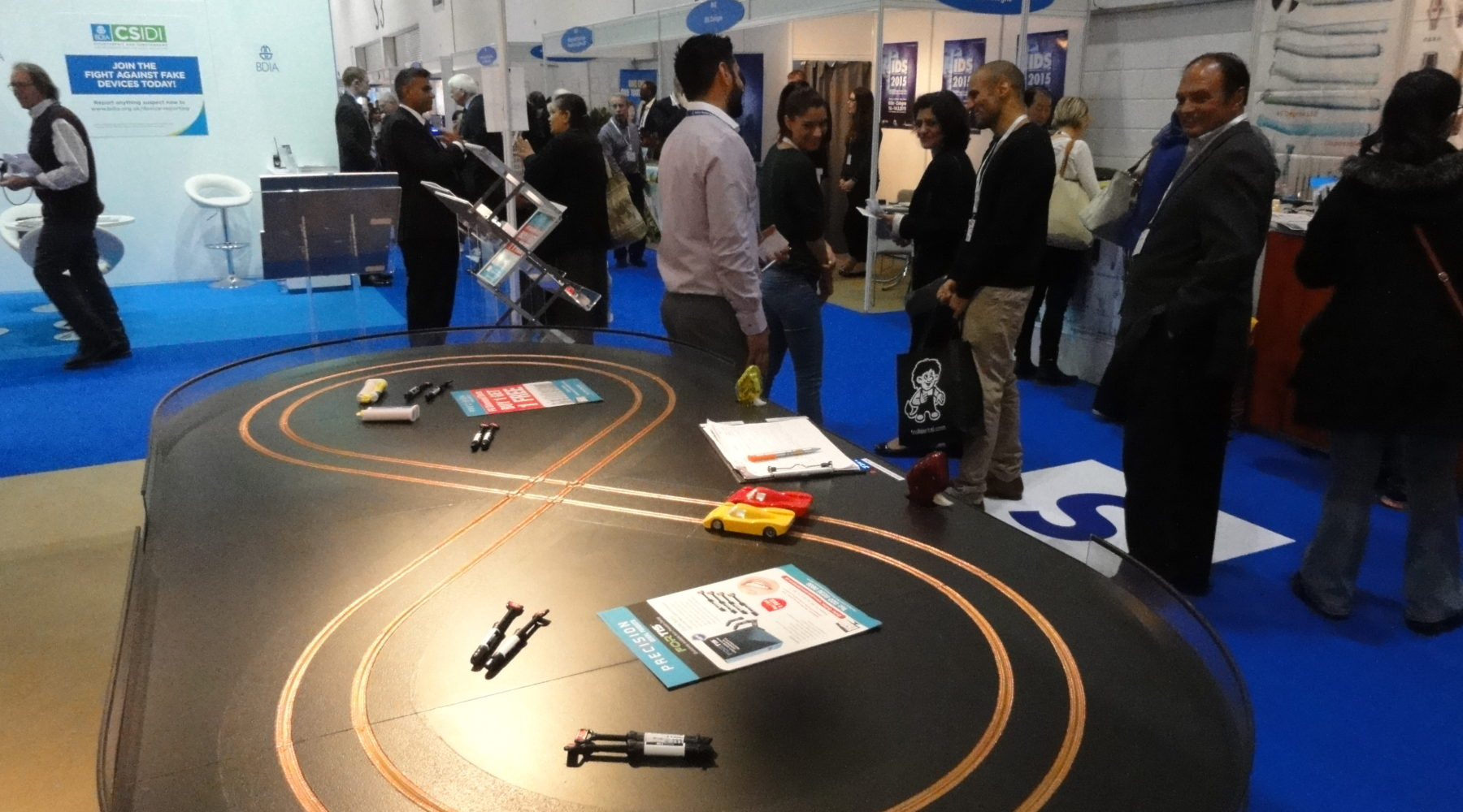 Miniracing Scaelxtric 2 lane track with custom branding on an exhibition stand