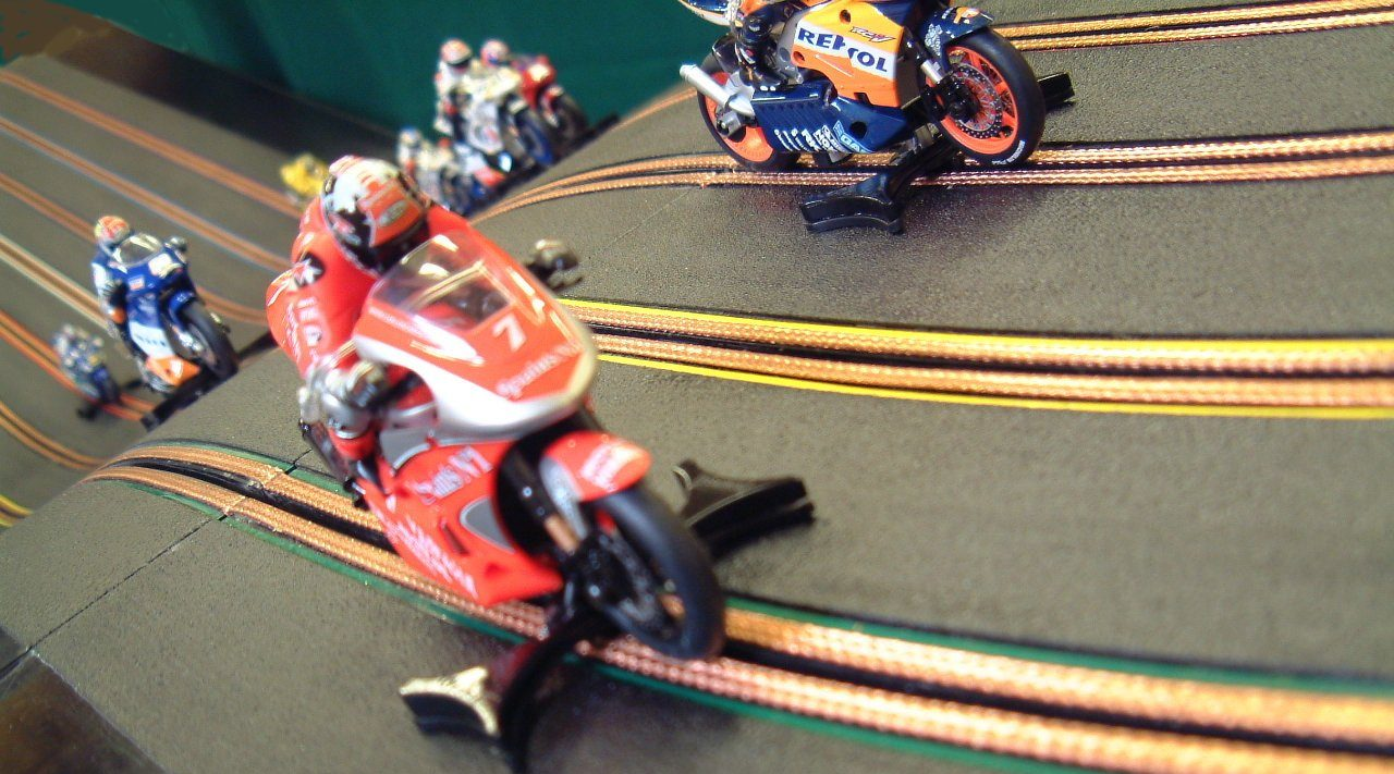 miniracing.com Giant Scalextric 8 Lane track racing with custom made moto GP motorbikes