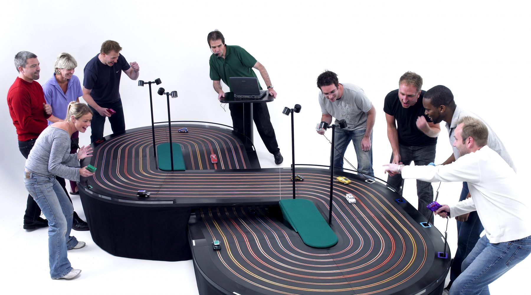 miniracing.com giant 8 lane scalextric track being used in a competition at an event